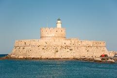 Mandraki harbor and the old lighthouse. Royalty Free Stock Image