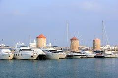The Mandraki harbor in Rhodes town, Greece. Stock Photography