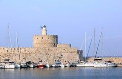 The Mandraki harbor in Rhodes town, Greece. Stock Image