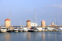 The Mandraki harbor in Rhodes town, Greece. Royalty Free Stock Images