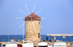 The Mandraki harbor in Rhodes town, Greece. Stock Photography
