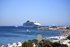 Cruise ship leaving the Deepwater Harbour on the island of Rhodes royalty free stock image