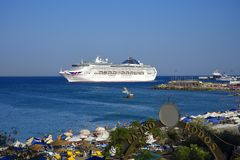 Cruise ship leaving the Deepwater Harbour on the island of Rhodes stock images