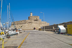 Mandraki harbour lighthouse tower (rhodes) Royalty Free Stock Photography