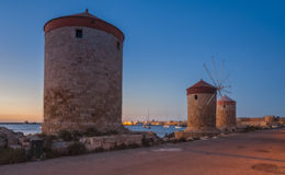 Mandraki Harbour windmills on the Island of Rhodes Greece Royalty Free Stock Images