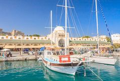 Mandraki Port and New Market  (�еа �го�а). Rhodes Island. Greece Royalty Free Stock Photography