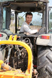 Mandriving argricultural vehicle Stock Image