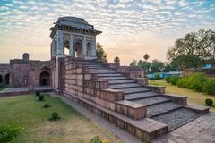 Mandu India, afghan ruins of islam kingdom, mosque monument and muslim tomb. Colorful sky at sunrise. Mandu India, afghan ruins of islam kingdom, mosque Stock Photo