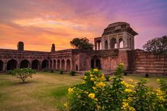 Mandu India, afghan ruins of islam kingdom, mosque monument and muslim tomb. Colorful sky at sunrise. Mandu India, afghan ruins of islam kingdom, mosque Stock Photography