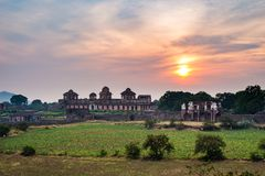 Mandu India, afghan ruins of islam kingdom, mosque monument and muslim tomb. Colorful sky at sunrise. Mandu India, afghan ruins of islam kingdom, mosque Stock Images