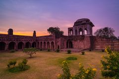 Mandu India, afghan ruins of islam kingdom, mosque monument and muslim tomb. Colorful sky at sunrise. Mandu India, afghan ruins of islam kingdom, mosque Royalty Free Stock Image