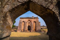 Mandu India, afghan ruins of islam kingdom, mosque monument and muslim tomb. View through door, Hindola Mahal. Mandu India, afghan ruins of islam kingdom Royalty Free Stock Images