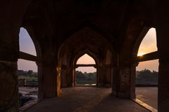 Mandu India, afghan ruins of islam kingdom, mosque monument and muslim tomb. View through door, Jahaz Mahal. Mandu India, afghan ruins of islam kingdom, mosque Stock Photo
