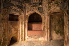 Mandu India, afghan ruins of islam kingdom, palace interior, mosque monument and muslim tomb. Sunshine from door in dark corridor. Stock Images