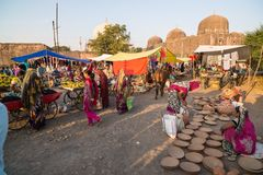 Saturday tribal market at Mandu, Madhya Pradesh, India, near the ancient mosque and islamic heritage. Mandu, India - December 2, 2017: saturday tribal market at stock photos