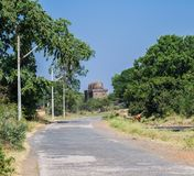 Mandu or Mandav Mosque and Road. Mandu or Mandav Historic Mosque with Three Domes and Road . Mandu was the capital of Malwa Sultanate in Central India during the royalty free stock photography