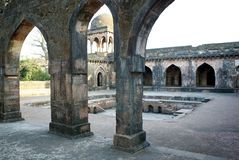 Mandu ruined city. Mandu is a ruined city in the Dhar district in the Malwa region of western Madhya Pradesh state, central India. Mandu's was earlier known by stock photo