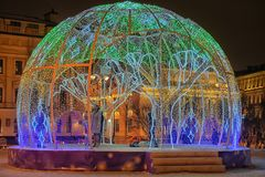 Manege Square..A dome of light garlands in which brighter elements depict trees. Russia, St. Petersburg 01,01,2019 Manege Square..A dome of light garlands in royalty free stock photo