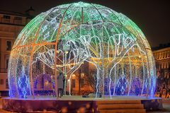 Manege Square..A dome of light garlands in which brighter elements depict trees. Russia, St. Petersburg 01,01,2019 Manege Square..A dome of light garlands in stock photos