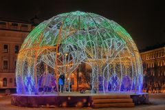 Manege Square..A dome of light garlands in which brighter elements depict trees. Russia, St. Petersburg 01,01,2019 Manege Square..A dome of light garlands in stock image