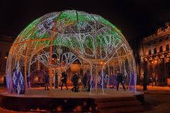 Manege Square..A dome of light garlands in which brighter elements depict trees. Russia, St. Petersburg 01,01,2019 Manege Square..A dome of light garlands in royalty free stock photos