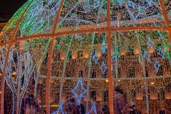 Manege Square..A dome of light garlands in which brighter elements depict trees. Russia, St. Petersburg 01,01,2019 Manege Square..A dome of light garlands in stock photography