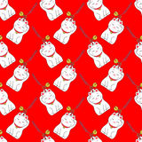 Maneki-neko 与日本幸运的无缝的样式 免版税库存图片