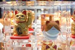Maneki neko. Many maneki neko or beckoning cat in a window in Asia Stock Image