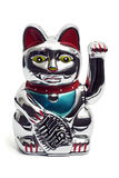 Maneki neko asian fortune cat. Maneki neko asian luck bringing fortune cat figurine isolated on white royalty free stock photo