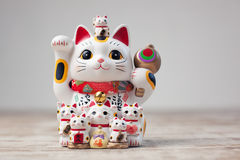 Maneki Neko cat. Common Japanese sculpture bring good luck to the owner stock photography