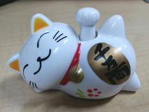 Maneki neko. Cat figure, accesories Stock Photo