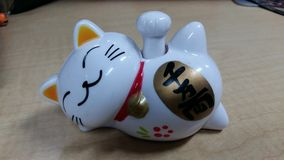 Maneki neko. Cats toy, swinginh cat Royalty Free Stock Photo