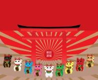 Maneki Neko colorea la tarjeta roja del sol de Japón Fotos de archivo