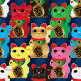 Maneki Neko colors symmetry seamless pattern. This illustration is drawing Japanese Maneki Neko with blue color Japanese sign in symmetry and seamless pattern Royalty Free Stock Photos