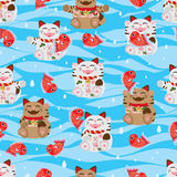 Maneki Neko happy fish sea seamless pattern. This illustration is drawing Japanese Maneki Neko happy with fish in sea and wave blue colors background in seamless Stock Photo