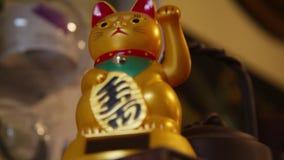 Maneki-neko, het Wenken kat stock footage