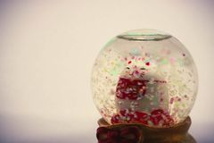 Maneki Neko Japan Lucky Cat in Snow globe , Isolated , Translation: Financial fortune stock photos
