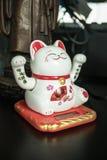 Maneki Neko Japanese lucky cat figure.  Stock Photos