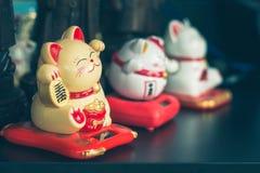 Maneki Neko Japanese lucky cat figures.  Royalty Free Stock Images