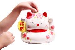 Maneki - neko. Maneki Neko, Japanese Welcoming Cat, Lucky Cat, Money cat Royalty Free Stock Images