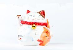 Maneki Neko, Japanese Welcoming Cat, Lucky Cat, Money cat.  royalty free stock photos