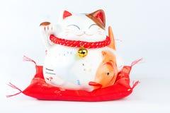 Maneki Neko is Japanese Welcoming Lucky and Money cat.  royalty free stock photo