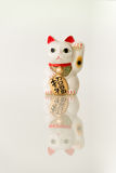Maneki Neko - Luckly Cat. Japanese beckoning cat (Maneki Neko) also means bring wealth to you while a right paw raised, currency sign for you to replace stock photos