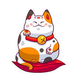 Maneki neko on red pillow Royalty Free Stock Images
