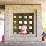 Maneki Neko Statue. Lucky cat known as Maneki Neko. Japanese Culture Stock Photos