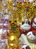 Lucky charm, talisman, maneki-neko, waving cat. The maneki-neko which in Japanese literally means  beckoning cat  is a common Japanese figurine a lucky charm stock images