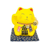Maneki Neko, Yellow lucky cat isolated. On white background royalty free stock image