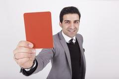Rött kort för affärsmanvisning Arkivbild