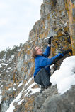 Manen klättrar vaggar Arkivfoton