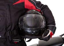 Manen i skyddande utrustar med hans motorbike Arkivbilder